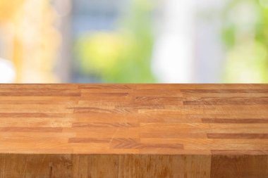 Empty wooden table over abstract bokeh background.