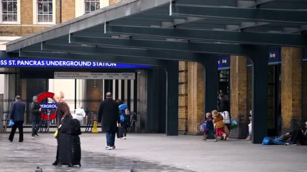 LONDON - MARCH 19, 2020: People exit King's Cross Railway Station and head towards The London Underground