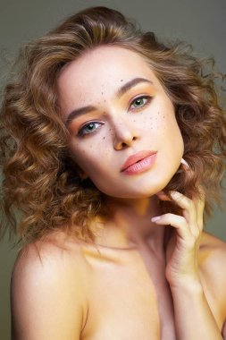 Beautiful woman. amazing curly girl with make-up
