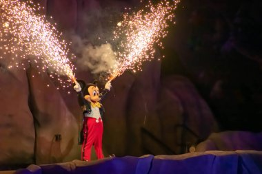 Orlando, Florida. March 19, 2019. Mickey mouse with fireworks coming out of his hands on Fantasmic Show at Hollywood Studios in Walt Disney World (1)