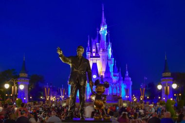 Orlando, Florida. March 19, 2019.View of Partners Statue This statue of Walt Disney and Mickey Mouse  is positioned in front of illuminated Cinderella Castle in Magic Kingdom at Walt Disney World .