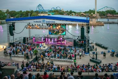 Orlando, Florida. March 17, 2019. Alexander Delgado and the band by Gente de Zona singing urban music at Seaworld in International Drive area.