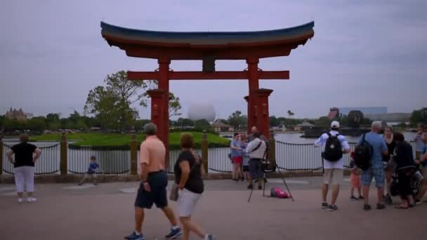 Orlando, Florida. May 15, 2019. Photographer taking pictures of people with Japan arch in Epcot at Walt Disney World Resort area