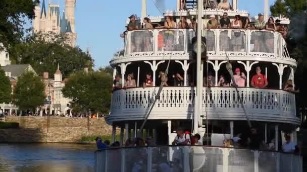 Orlando, Florida. September 29, 2019. Liberty Square Riverboat sailing and partial view of Cinderella Castle at Magic Kingdom (2).