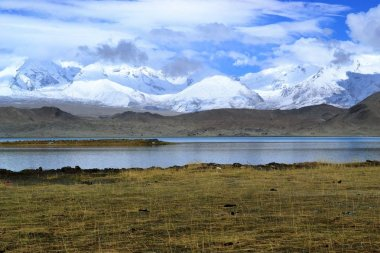 Karakul lake and pamir mountains in Xinjiang, Karakorum highway, China