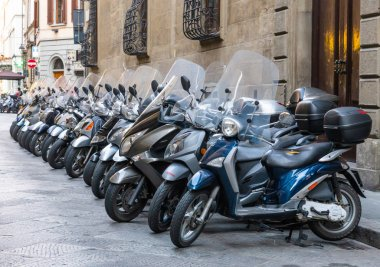 Motorcycle squad parked their iron horses outside in Florence, Italy