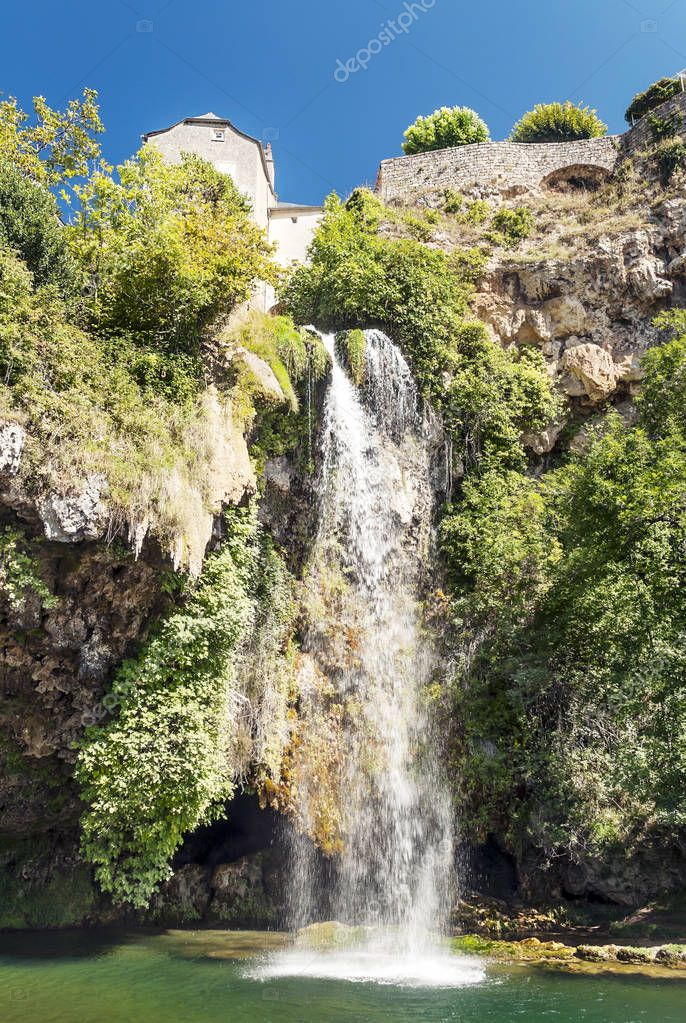 Waterfall in a lake in the south of France on a sunny day