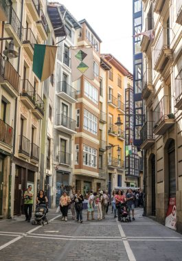 Pamplona, Navarra, Spain-September 2018. Streets of Pamplona in Navarre with people walking and buildings on both sides. Pamplona, capital of the province of Navarra, is a city in northern Spain. It is known mainly for the celebration of bullfights (