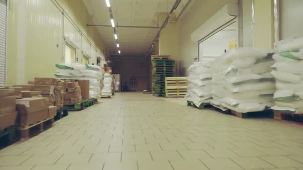 general view of the warehouse with boxes and furniture. moving between palettes with goods and materials at warehouse.