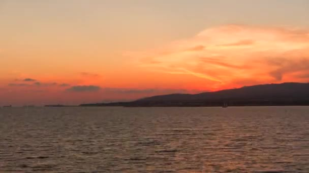 Beautiful sunset over sea and yacht. Professional time lapse, no flicker.
