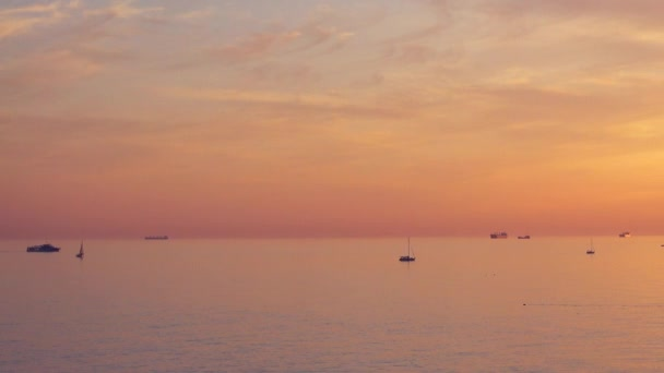 Panoramic shoot, majestic sunset and many different ships and yachts in the sea.