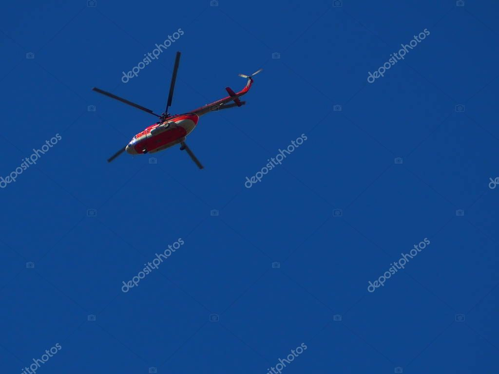 helicopter flying in blue sky, travel concept