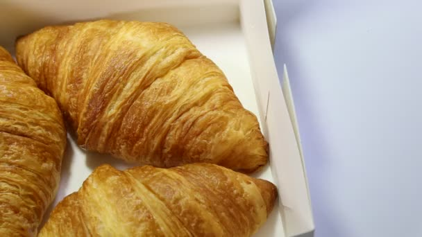 croissant lies on a white background. baked goods on isolated background