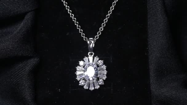 A necklace with a beautiful shining diamond pendant.