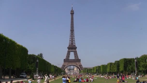 Paris, France - Circa July 2013: Eiffel Tower on the Champs de Mars, with people relaxing on the lawn on a hot summer day