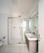 Fotografie Front view modern bathroom with shower and sink. Nobody inside