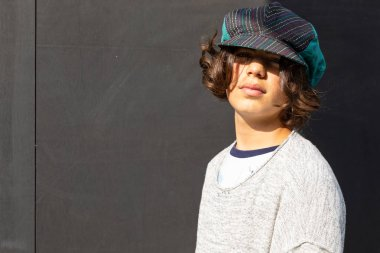 Portrait of boy with colorful hat