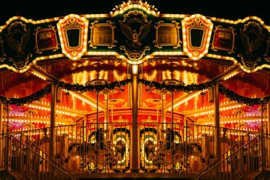 partial view of beautiful carousel with many light at night in theme patk