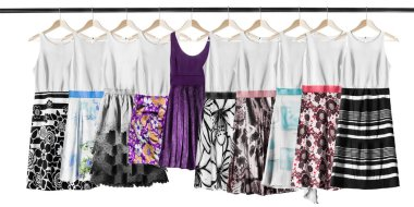 Group of sundresses hanging on clothes racks isolated over white