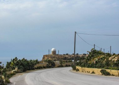 Radar station and Dingli cliffs and majestic views of the Mediterranean sea and the lush countryside, Malta, Europe