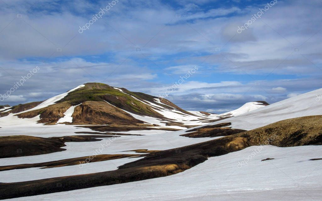 Scenic view on colorful rhyolite mountains of active geothermal area Jokultungur in sunny day, Laugavegur trail (Laugavegurinn), near Landmannalaugar, Fjallabak Nature Reserve, Highlands of Iceland