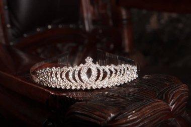 Elegant diamond diadem on wooden background
