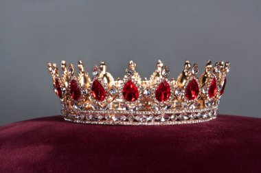 Royal jewel crown with rubies on grey background