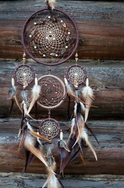 Traditional indian talisman dreamcatcher on wooden background