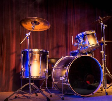 Close view of drum set in colorful light