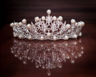 Luxury crown with gem stones on brown background