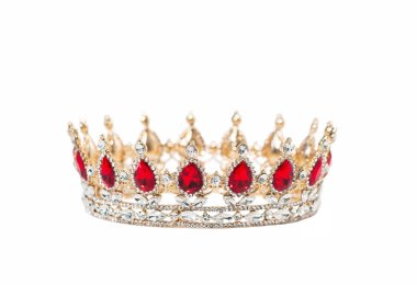 Crown with red gemstones isolated on white background