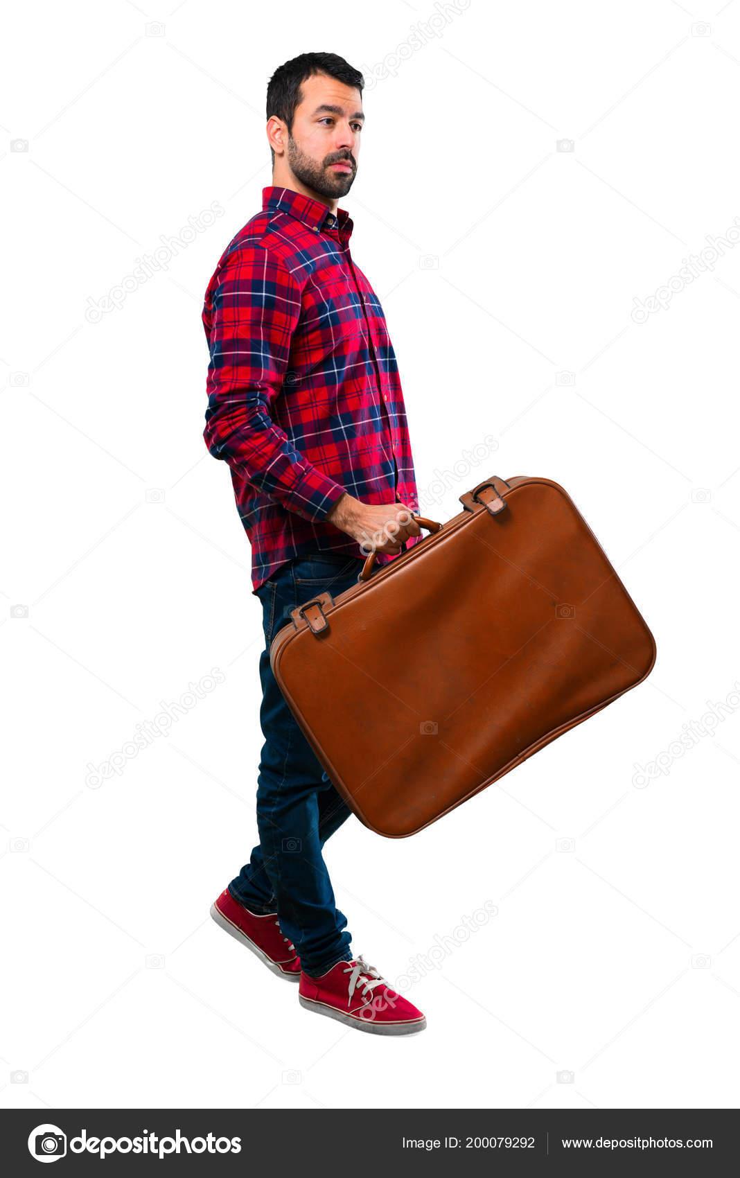 Красивый мужчина держащий винтаж портфель — стоковое фото.