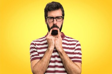 Sad man with glasses on colorful background