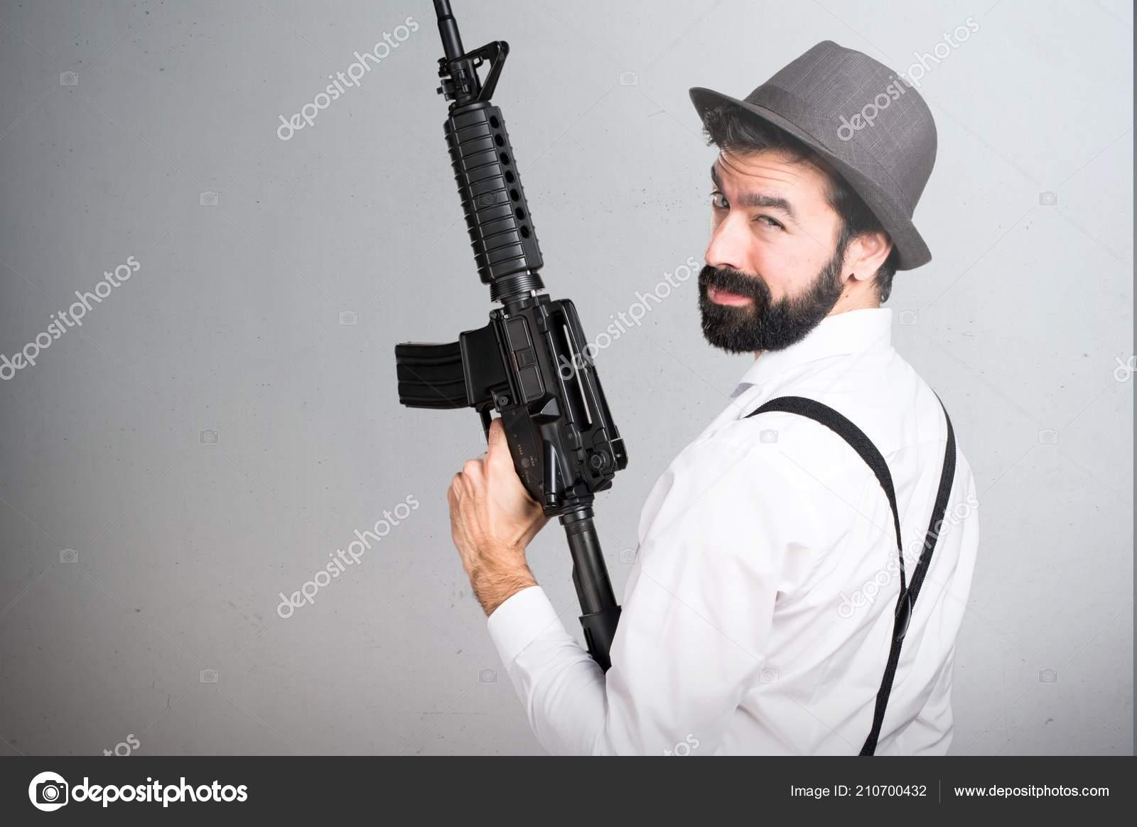 Hipster Man Beard Holding Rifle Grey Background — Stock