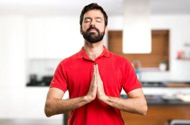 Handsome man in zen position inside house stock vector