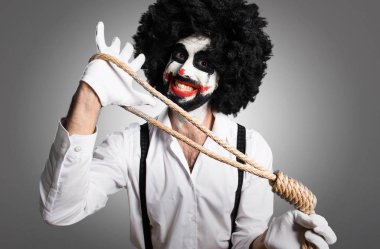 Killer clown  with slipknot on textured background