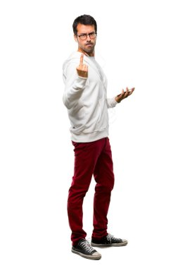 Full body of Man with glasses and listening music making horn gesture. Negative expression on white background