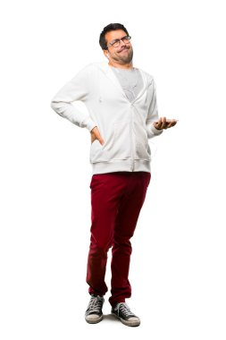 Full body of Man with glasses and listening music unhappy and suffering from backache for having made an effort on white background
