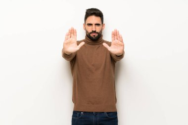Handsome man over white wall making stop gesture for disappointed with an opinion stock vector