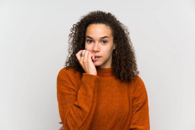 Dominican woman over isolated white wall nervous and scared