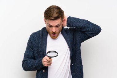 Redhead man with magnifying glass
