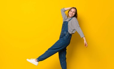 Young girl over isolated yellow background