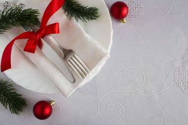 Christmas table setting on the white tablecloth.Top view.Copy space.