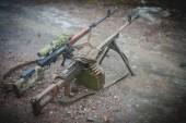 Machine gun and  sniper rifle on military firing
