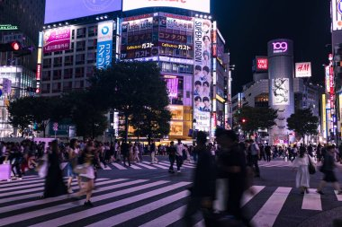 TOKYO, JAPAN - August 20, 2019 : Shibuya Scramble Crossing at night. Motion blur. Selective Focus.