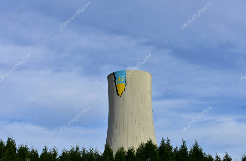 Greenpeace action at Meirama Power Station, Spain. NO COAL! campaign. Graffiti on a chimney with a sun drawing.