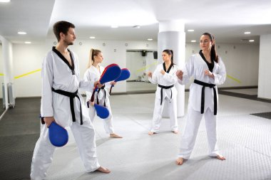 Taekwondo training with kick pad targets
