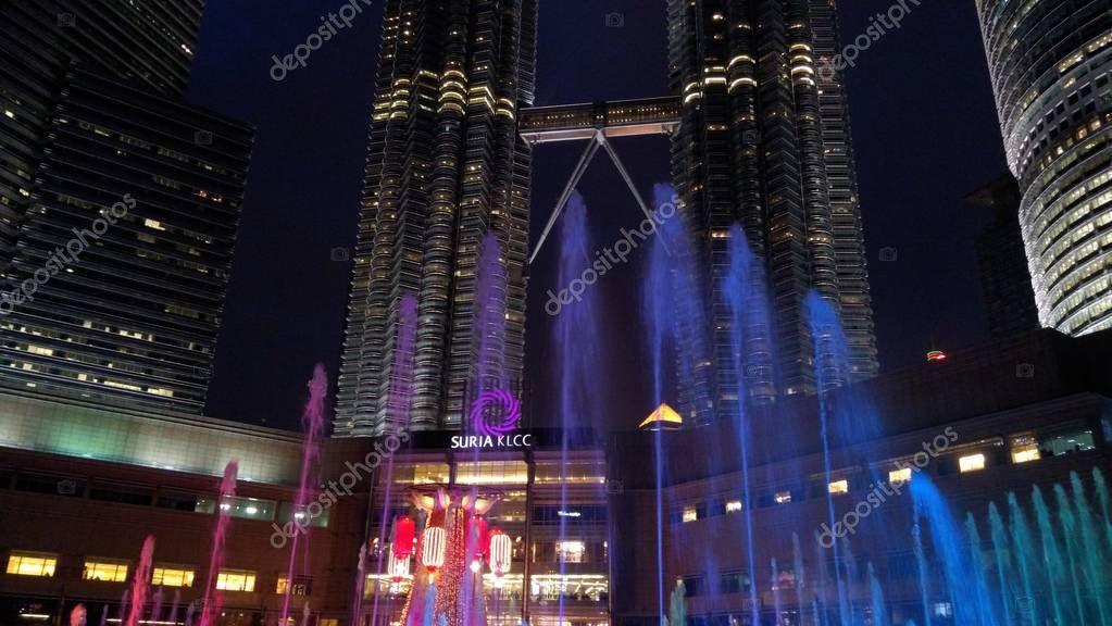 KUALA LUMPUR, MALAYSIA - February 6, 2018: Petronas Twin Towers with Musical fountain at night in Kuala Lumpur, Malaysia.