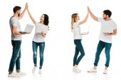 happy young couples holding laptops and giving high five isolated on white