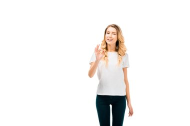 beautiful young woman showing ok sign and winking at camera isolated on white